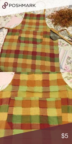 Country Kitchen Apron Cute kitchen apron! I never used it to cook in- used as decoration. Unsure of name-brand or fabric content etc. There aren't any tags on it. Other