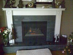 A reno. Ripped off old hunter green tiles and replaced them with grey tiles and a honed black slate hearth Fireplace Hearth, Fireplace Ideas, Fireplaces, New England Cottage, Slate Hearth, Green Tiles, D Gray, Cottage Style Homes, Hot Spots