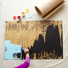 Drag a squeegee to make wall art.