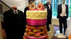 "(Image credit: Dunkin Donuts Bahamas/Facebook) The possibilities are endless when it comes to wedding cakes. The Swiss Pastry Shop in the Bahamas created this wedding cake made out of donuts for the annual wedding show. A Dunkin' Donuts manager asked the bakery to create the cake for the wedding show.  They later posted the final cake on their Facebook page. ""We researched it beforehand…so we just kind of incorporated a combination of different designs,"" said Manfred Ginter, son of the…"
