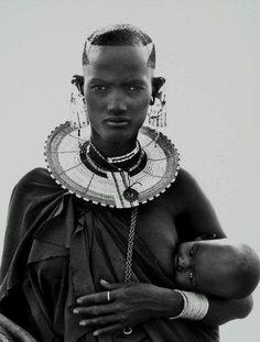 Woman breastfeeding african