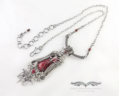 """Freya"" -- Fierce but beautiful, this pendant necklace features an Alumilite cabochon w/ a faceted Ruby (.75ct) dressed in Fine Silver."