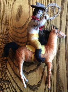 antique spun cotton Christmas ornament, cowboy on horse, 5.25 in. high  |
