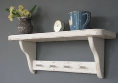 Rustic peg shelf white washed. From Not on the High Street