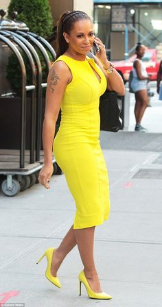 She'll stop traffic in that: Mel B leaves her New York hotel to head to auditions for America's Got Talent in a bright yellow dress