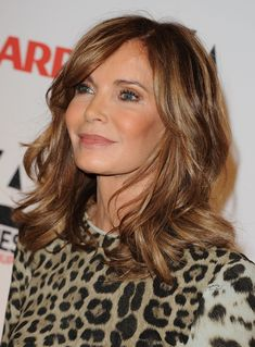 The Best Hairstyles for Women Over 50: Long, Wavy Hair: Utterly Youthful. Also keep in mind that Smith is past 65 (!!) but looks like she's in her late 40s or early 50s thanks to plastic surgery. If she had a face full of wrinkles, this youthful hairstyle might look odd on her. But her face is lineless and she looks amazing.