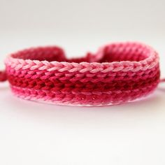 crochet friendship bracelet...  Maybe in blue, gold, and white for the girls?