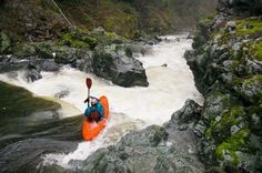 A kayaker hits rapids on the Smith River near the southwest border of Oregon and California in the Siskiyou Gorge .