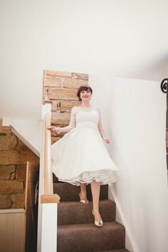 Lace sleeves and modest bodice on short gown.   Lisa and Kevin's 'Rustic Vintage Ski' Themed Wedding With a Load of DIY Touches by Chris Milner