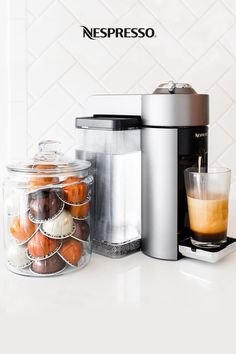 Looking for coffee station ideas to keep your kitchen organized? Here are three tips for keeping your Nespresso Nook clean and tidy. | 1.) Store your capsules in a clear jar for a pop of color. | 2.) Define your coffee bar area by using a pretty tray to corral accessories like your Aeroccino milk frother, syrups, and other add-ins. | 3.) Take advantage of vertical space by hanging hooks or floating shelves to display your favorite coffee mugs. Nespresso Recipes, Nespresso Usa, Nespresso Boutique, Coffee Nook, Home Coffee Stations, Tea Mugs, Coffee Mugs, Coffee Is Life, Summer Drinks