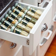 Slip a tiered rack inside a drawer to keep spices neatly contained.  ...if only i had more drawer space ;)