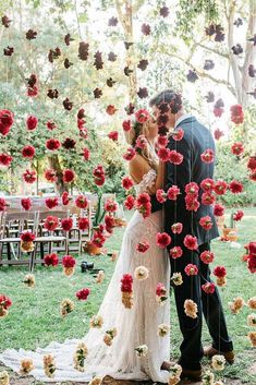 Wedding Day cheap wedding decorations wall of red flowers behind which the kiss of the bride and groom cara robbins studio - Elegant doesn't mean expensive. You can make unique and cheap wedding decorations. Mumu Wedding, Wedding Goals, Chic Wedding, Perfect Wedding, Dream Wedding, Wedding Day, Wedding Photos, Luxury Wedding, Wedding Ceremony