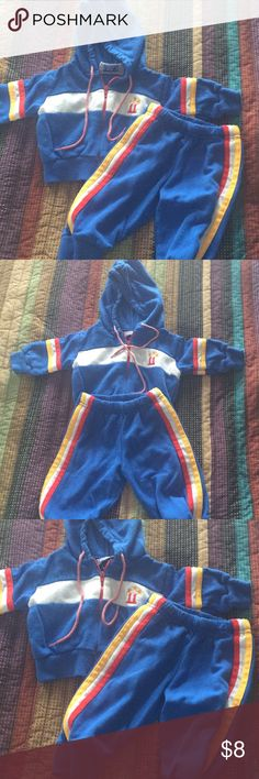 Adorable vintage track suit Vintage Matching coat and pants for kiddo.  Blue red yellow and white make this suit cute for any child.  No stains.  Some wear and age due to vintage Matching Sets