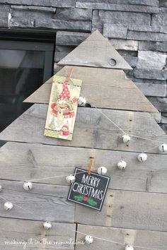String a set of jingle bells in a zig-zag pattern to showcase Christmas cards on a pallet tree (brilliant!).