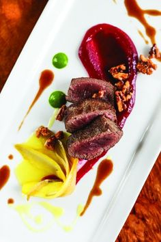 Venison backstrap with cranberry compote, braised endive, and spiced walnuts from Halcyon