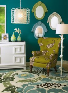 Dark teal walls accented by lime green and white. Jewel-like and perfect. Too Mature? What colors or styles do you like? Hailey used a pink and green toile until she was 14. I put her room on my fb , it's french. champaine , black,and glass.