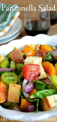 Panzanella Salad is a classic Tuscan tomato and bread salad that is the perfect way to showcase ripe colorful produce and a fabulous oil and vinegar. #salad #bread #Italian #tomato #easy #Tuscan #healthy #heirloom via @https://www.pinterest.com/slmoran21/