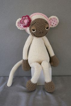 cute knitted amigurumi monkey - it's posture is almost speaking to me!