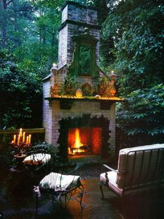 I love how this one is a standalone fireplace with woods as the backdrop