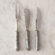 "The perfect trio for an elegant hostess, this antique pewter serving set is anchored by handles cast from natural birch branches. Each set is hand-crafted by designer Michael Michaud.- Set of 3- Pewter- Hand wash with mild soap and soft cloth- Handmade in the USAEach: 0.5""W, 5.5""L"