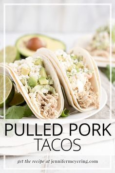 Low and slow cooked pulled pork piled high on some tortillas then topped with coleslaw, avocado cream, and queso fresco.
