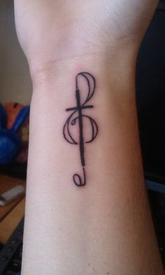 My tattoo. Mix of a music note and a cross to represent music and christianity