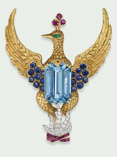AN AQUAMARINE AND MULTI-GEM BROOCH, MOUNTED BY CARTIER  Modelled as a phoenix rising from the ashes, the central rectangular-shaped aquamarine to the textured body and wings mounted with circular-shaped sapphires, with emerald eye and ruby plume detail, the diamond-set flames accented by calibré-cut rubies, late 1950's, 7.0cm high, with French assay marks for platinum and gold Signed Monture Cartier