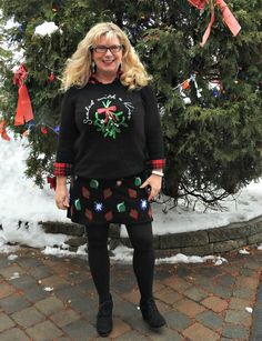 sealed with a kiss H&M sweater and a Target Christmas skirt, worn with black wedge boots