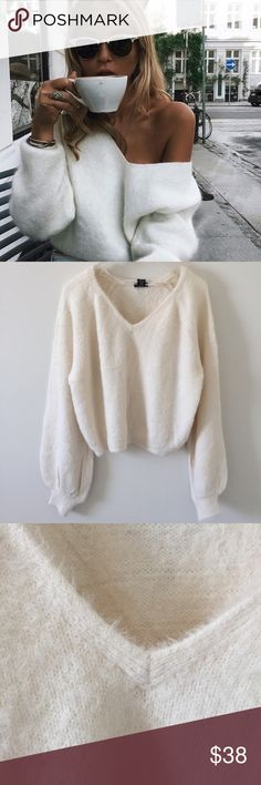 "NEW""Bongiorno""Fuzzy Sweater Creamy and cozy sweater with billowy sleeves and a v-neckline.  This is a boutique listing. Item comes brand new without label or tag. Sweaters V-Necks"