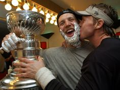 Kirk Maltby and Kris Draper with the Stanley Cup, 2002