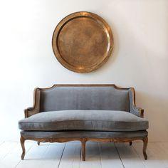 Vintage settee reupholstered in grey velvet from Nickey Kehoe.