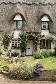 English Cottage | Flickr - Photo Sharing!  The design on the top of the thatch roof is the Thatcher