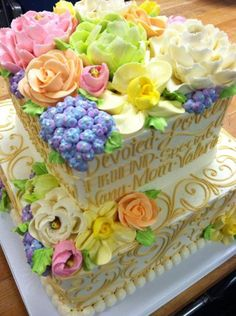 Buttercream flowers (Cakes).  Just give me the flowers, you can eat the cake.  Well, most of it.  But I get all the flowers.