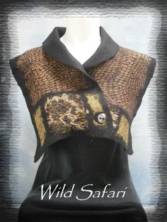A simple shrug. A length of fabric, slit up the center to the midpoint. A strip of fabric added to the slit area creates a collar, and felt it all together.