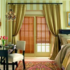 Different colors, but love the blinds and curtains over the doors.  Replicate on windows in living room