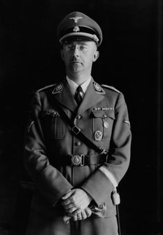 "fuehrer3345: "" SS-Reichsfuhrer Heinrich Himmler uniform analysis Wearing SS wartime uniform in a studio portrait photo His rank indicating his sole status head of the SS shown by his unique collar patches, his narrow shoulder boards style with its..."