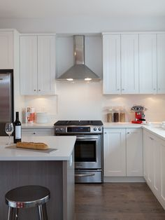 similar to what our cabinets would look like painted? this kitchen is blah tho.