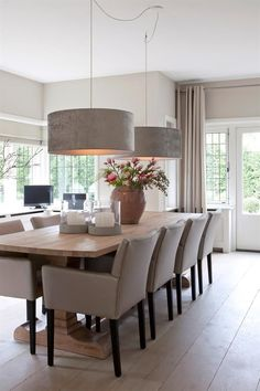 Dining room, drum pendant lights, neutral colors, French doors, curtains hung to the ceiling