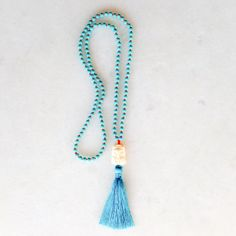 Buddha tassel necklace with turquoise howlite