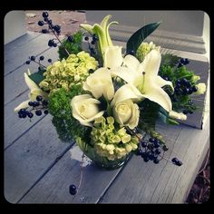 Sympathy arrangement using white lilies, roses, hydrangea, godetia and black berries.  Roberts Flowers of Hanover, Hanover, NH