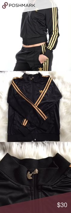 Adidas Black and Gold Strip Jacket Pre owned in good conditions has peeling on neck and sweater hem as shown on photos other than that it's in great condition. Does not have size tag but fits like a small/medium adidas Sweaters