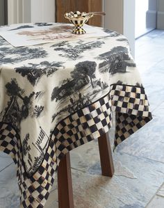 The Aurora Toile Table Topper puts a spin on a classic.