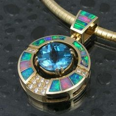 Australian opal inlay with blue topaz