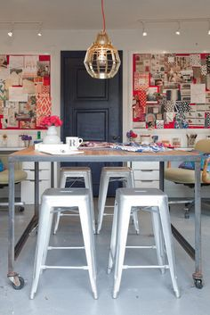 love this use of space, the large table can be used for so many things, and the light fixture is interesting