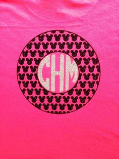 Minnie Mouse shirt with bow on the front with circle monogram and Mickey heads on the back with circle monogram. Shirt made with glitter
