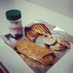 Breakfast Wrap on Tomato Basil Tortilla (scrambled egg, mayonnaise, sausage and cheese), Homemade Fish Cakes, Ham and Cheese Panini & a Yogurt Parfait