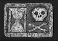 Skull and Crossbones with Sands of Time  Symbols of mortality and Viking runes are powerfully carved in this 17th century Scottish grave slab.  Dedicated to a member of the Campbell and Roy clans.  These symbols also have a relationship to the Knights Templar and the early Masonic order and are found in many old graveyards in Scotland.