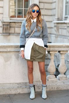 Cropped sweatshirt over long buttondown and short skirt