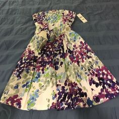 *NWT* Floral strapless dress from Nordstrom Brand new with tags from Nordstrom. Strapless with pleated full skirt,  pockets, and matching belt. Smocking in the back for a custom fit. Perfect for a spring wedding, Easter, prom, etc. Muse Dresses Strapless