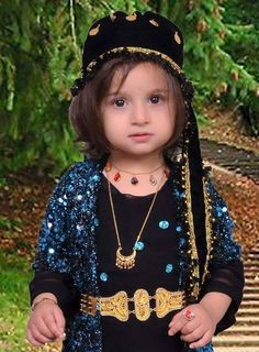 Adorable Kurdish Girl wearing a traditional Dress, Jewelry and Headgear. ➡ https://m.facebook.com/Kurdish-Clothing-کراسی-کوردی-234276190043551/?refid=13